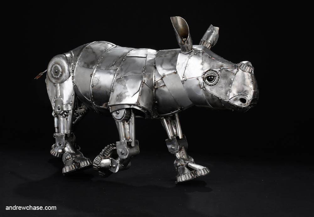 Andrew chase baby rhino metal sculpture trotting